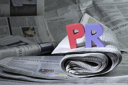 Word PR on newspaper. Marketing and PR