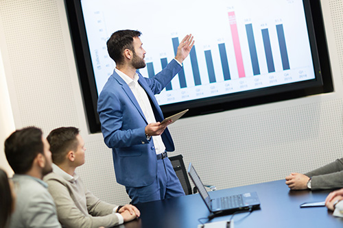 Picture of business meeting in modern conference room, presentation